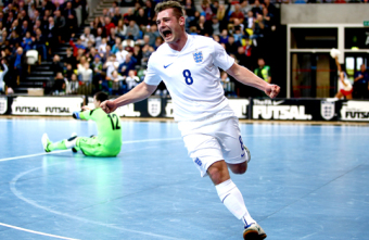 Luke Ballinger presented with golden cap to mark 100 England futsal appearances