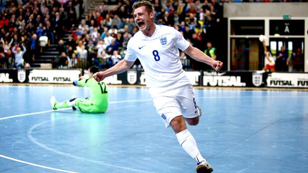 Luke Ballinger presented with golden cap to mark 100 England futsal appearances