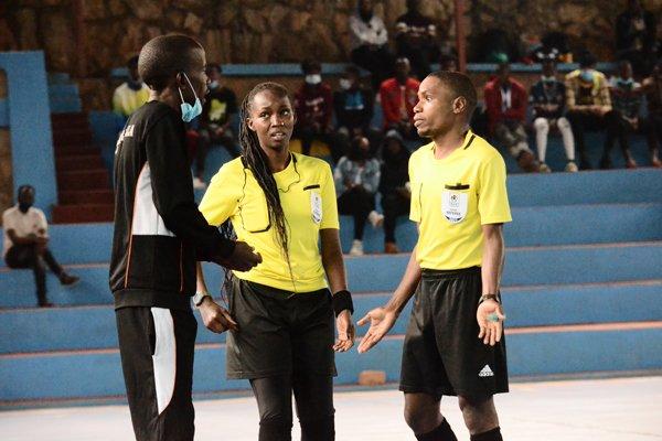 Rashida Adams earning her refereeing stripes in futsal in Uganda